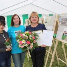 """Konkursa """"Latvijas lauki gadsimtu griežos"""" darbu izstādes atklāšana Likteņdārzā 2018. gada 4. maijā"""